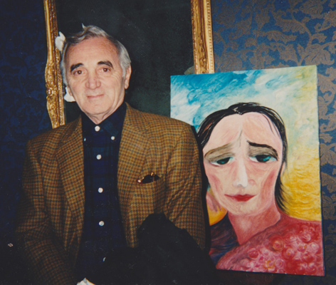 Charles Aznavour with his portrait by Jenny Batlay